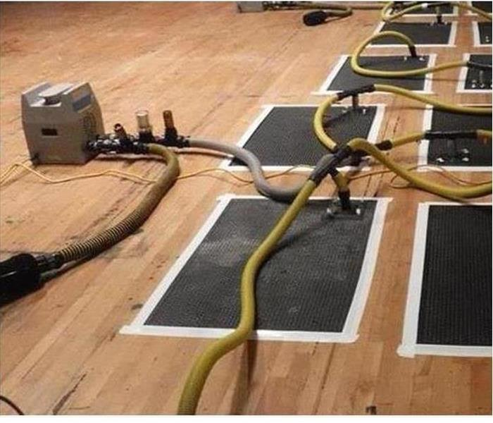 Monument Water Damage to a Gym Floor